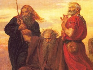 moses-holding-up-his-arms-during-the-battle